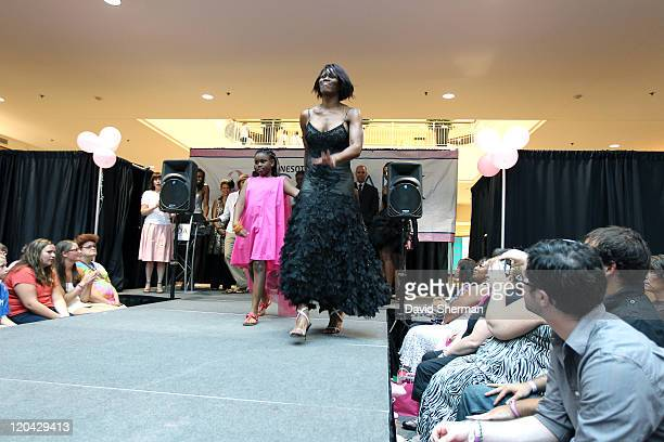 Taj McWilliamsFranklin of the Minnesota Lynx and her daughter participate in Catwalk for a Cure fashion show fundraiser to benefit the Lynx...