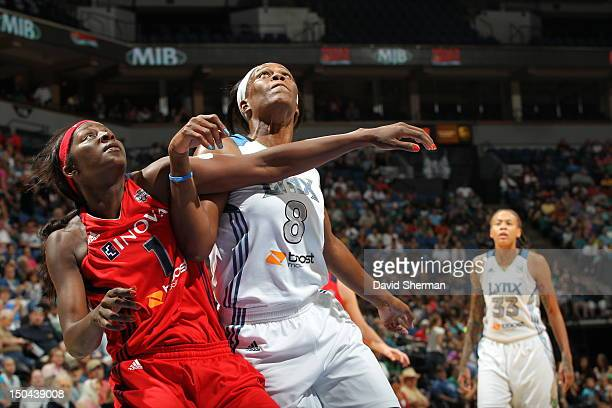 Taj McWilliamsFranklin of the Minnesota Lynx boxes out for a rebound against Crystal Langhorne of the Washington Mystics during the WNBA game on...