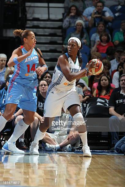 Taj McWilliamsFranklin of the Minnesota Lynx looks to pass the ball against Erika de Souza of the Atlanta Dream during the WNBA game on September 7...