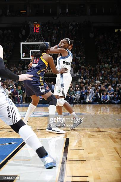 Taj McWilliamsFranklin of the Minnesota Lynx looks to pass the ball against Jessica Davenport of the Indiana Fever during the 2012 WNBA Finals Game...