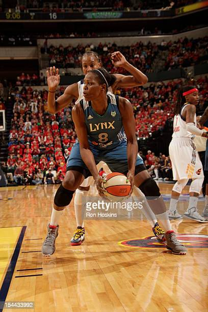 Taj McWilliamsFranklin of the Minnesota Lynx protects the ball against Tamika Catchings of the Indiana Fever during Game three of the 2012 WNBA...