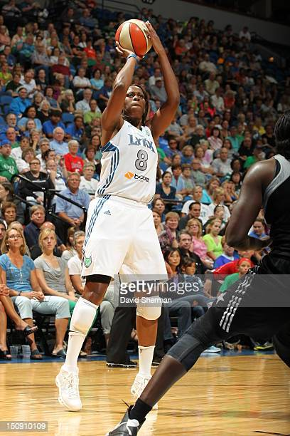 Taj McWilliamsFranklin of the Minnesota Lynx shoots the ball against Sophia Young of the San Antonio Silver Stars during the WNBA game on August 28...