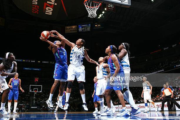 Taj McWilliamsFranklin of the New York Liberty gains control of the ball during the WNBA game against the Washington Mystics at the Verizon Center on...