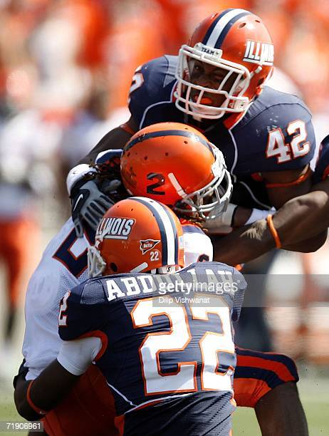 Taj Smith of the Syracuse Orangemen is tackled by Kieron Frazier Justin Ijei of the Illinois Fighting Illini on September 16, 2006 at Memorial...