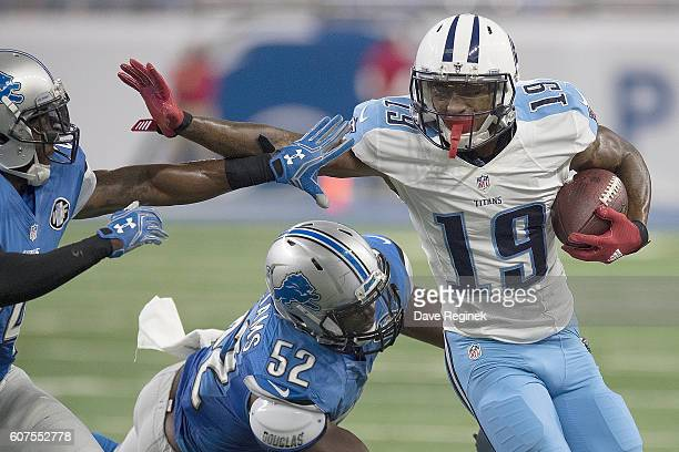 Tajae Sharpe of the Tennessee Titans fights off Nevin Lawson of the Detroit Lions and Antwione Williams of the Detroit Lions during 1st half action...
