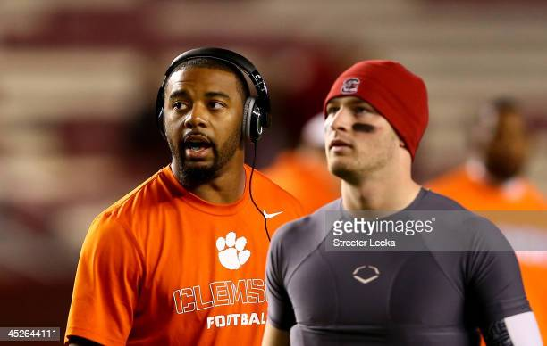 Tajh Boyd of the Clemson Tigers and Connor Shaw of the South Carolina Gamecocks talk before their game at WilliamsBrice Stadium on November 30 2013...