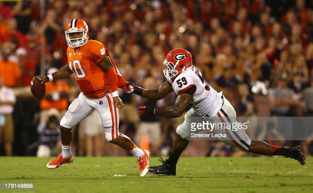 Tajh Boyd of the Clemson Tigers avoids being tackled by Jordan Jenkins of the Georgia Bulldogs in the second quarter at Memorial Stadium on August 31...