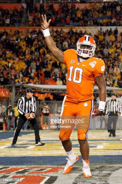 Tajh Boyd of the Clemson Tigers celebrates after he threw a 27-yard touchdown pass to Sammy Watkins in the second quarter against the West Virginia...