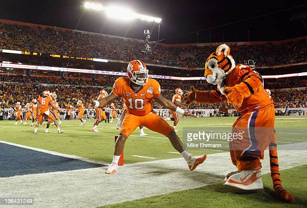 Tajh Boyd of the Clemson Tigers celebrates with the CLemson mascot after he threw a 27-yard touchdown pass to Sammy Watkins in the first quarter...