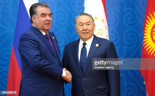 Tajikistan's President Emomali Rahmon and Kazakhstan's President Nursultan Nazarbayev shake their hands ahead of a meeting of the Shanghai...