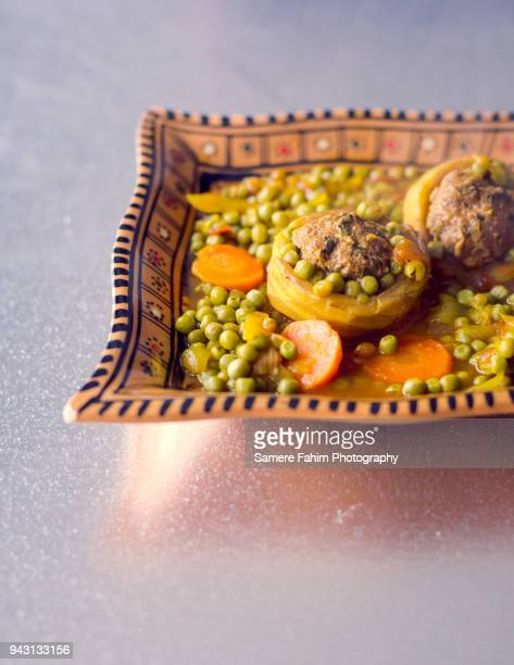 Tajine of Kefta with artichokes and peas