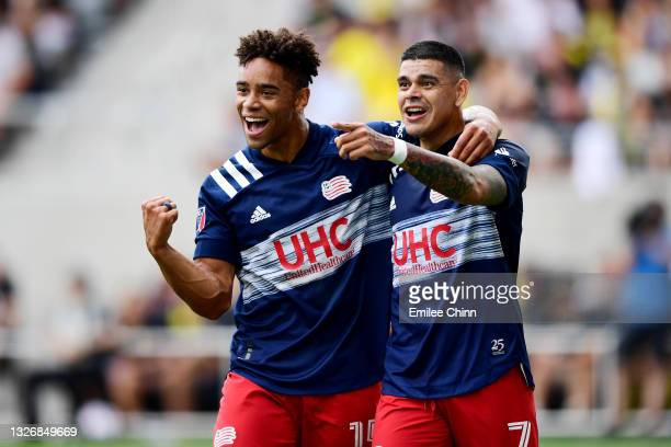Tajon Buchanan and Gustavo Bou of New England Revolution celebrate Bou's goal in the first half during their game against the Columbus Crew at...