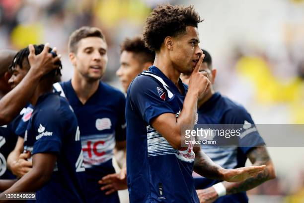 Tajon Buchanan of New England Revolution silences the crowd after a goal by Gustavo Bou in the first half during their game against the Columbus Crew...