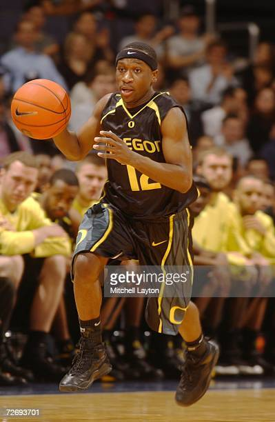 Tajuan Porter of the Oregon Ducks dribbles the ball up court during a college basketball game against the Georgetown Hoyas at Verizon Center on...