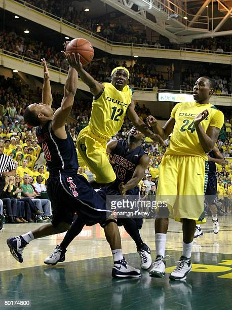 Tajuan Porter of the Oregon Ducks lays up the ball over Jerryd Bayless of the Arizona Wildcats at McArthur Court March 8, 2008 in Eugene, Oregon.