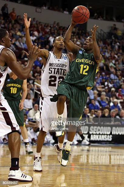 Tajuan Porter of the Oregon Ducks shoots over Barry Stewart of the Mississippi State Bulldogs during the first round of the South Regional as part of...