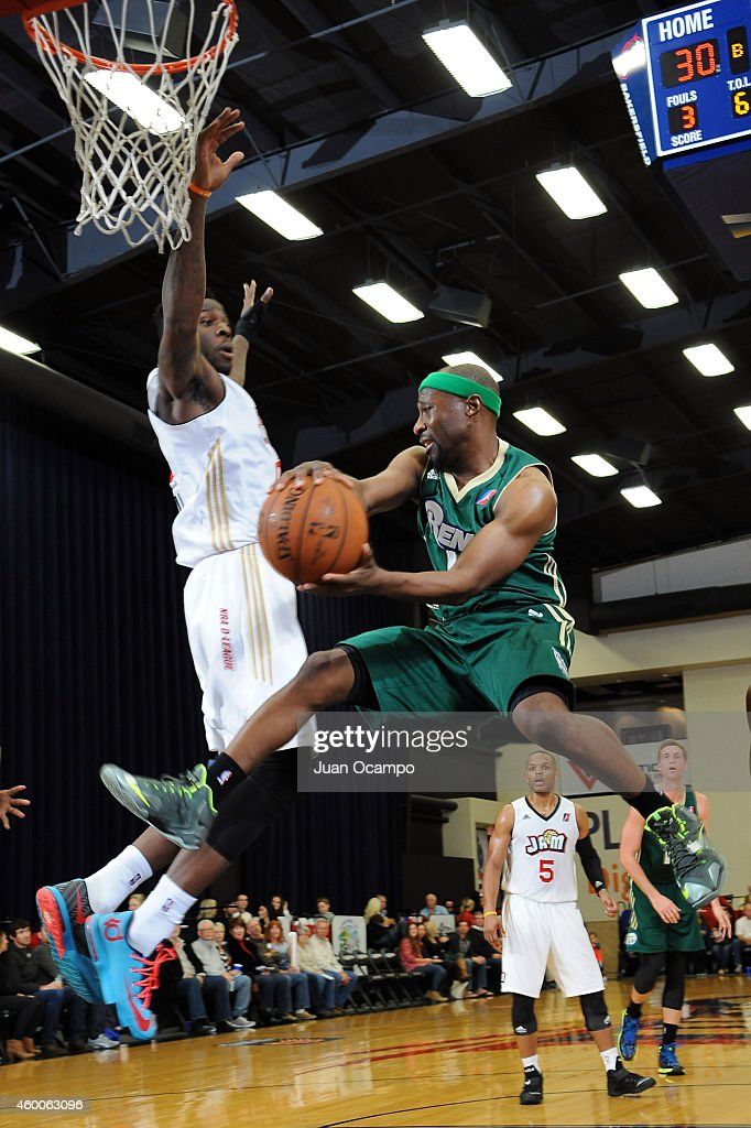 Tajuan Porter #12 of the Reno Bighorns looks to make a pass under the basket against Jamil Wilson #0 of the Bakersfield Jam during a D-League game on December 5, 2014 at Dignity Health Event Center in Bakersfield, California.