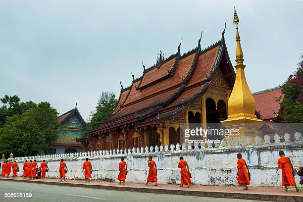 Tak Bat or the morning rice almsgiving which is the Buddhist monks' morning collection of food Pictured here in front of Vat Sensoukarahm temple in...