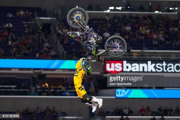Taka Higashino dangles from his dirtbike during Moto X Freestyle at X Games Minneapolis on July 14 2017 at US Bank Stadium in Minneapolis Minnesota