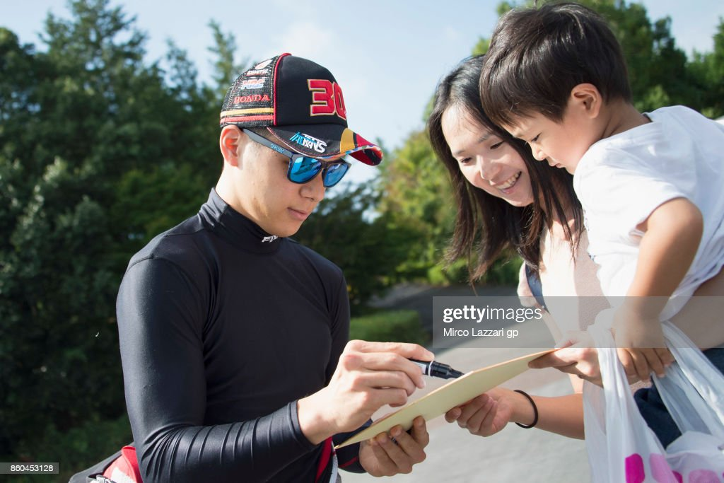 Takaaki Nakagami of Japan and Idemitsu Honda Team Asia signs autographs for fans during the pre-event 'The mini-battle between the MotoGP riders and children with electric mini bikes at Mobi Park at Motegi' ahead of the MotoGP of Japan at Twin Ring Motegi on October 12, 2017 in Motegi, Japan.