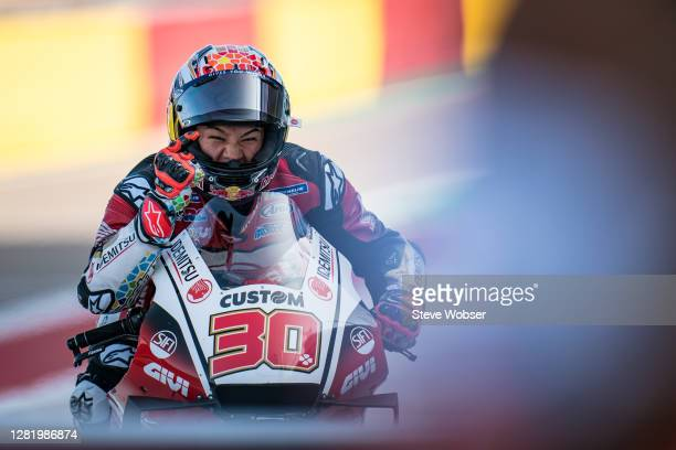 Takaaki Nakagami of Japan and LCR Honda IDEMITSU rolls into the parc ferme after his first ever MotoGP pole position during the qualifying for the...