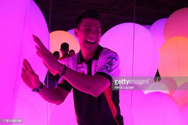 """Takaaki Nakagami of Japan and LCR Honda Idemitsu smiles during the pre-event """"MotoGP riders visiting at the TeamLabs Digital Art Museum situated in..."""