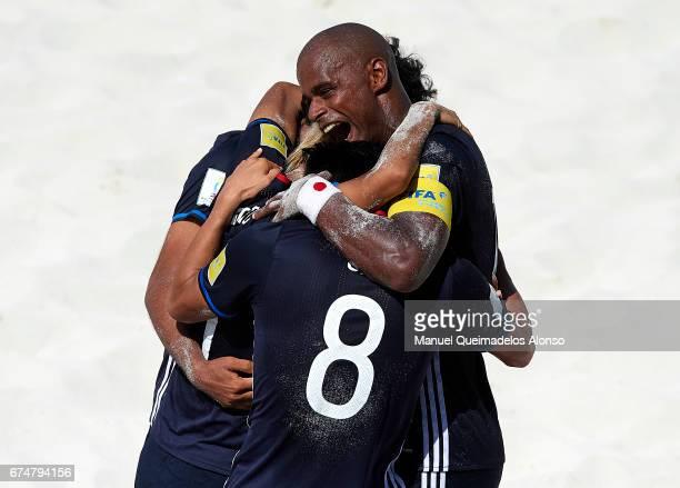 Takaaki Oba Shusei Yamauchi and Ozu Moreira of Japan celebrate a goal during the FIFA Beach Soccer World Cup Bahamas 2017 group D match between Japan...