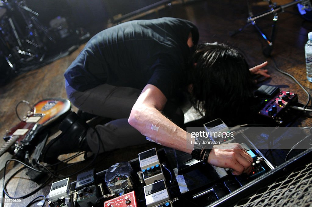 Takaakira Taka Goto Of Mono Performs On Stage Using Guitar Effects Pedals At The