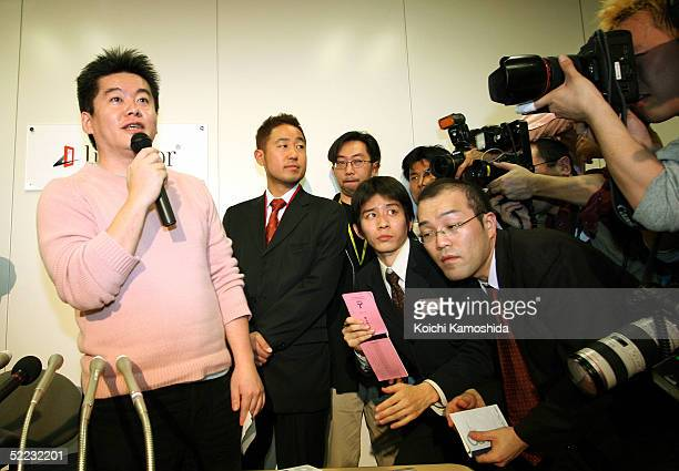 Takafumi Horie president and CEO of Japanese software distributor Livedoor Co answers questions during a news conference February 23 2005 in Tokyo...