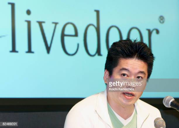 Takafumi Horie president and CEO of Japanese software distributor Livedoor Co attends a press conference on March 23 2005 in Tokyo Japan Livedoor...