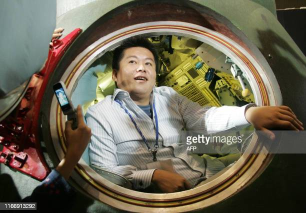 Takafumi Horie President of Japan's internet service provider Livedoor Co speaks from inside of a space capsule from the manned Russian military...