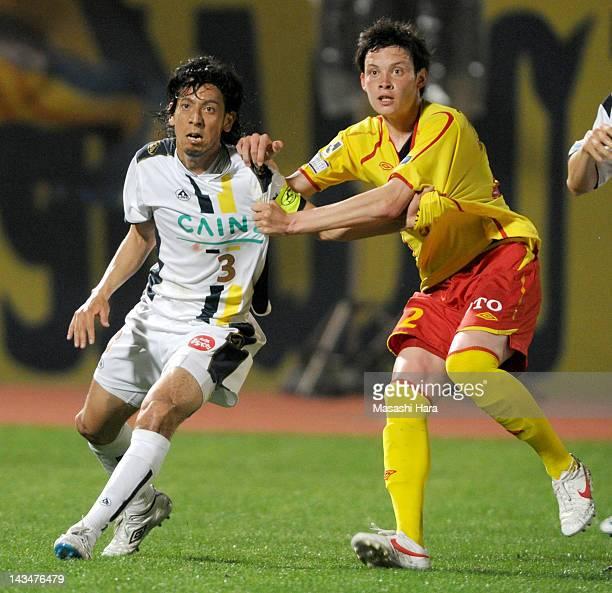 Takafumi Mikuriya of Thespa Kusatsu and Colin Killoran of Giravanz Kitakyushu compete during the JLeague Second Division match between Thespa Kusatsu...