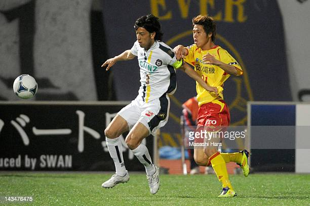 Takafumi Mikuriya of Thespa Kusatsu and Jin Hanato of Giravanz Kitakyushu compete during the JLeague Second Division match between Thespa Kusatsu and...