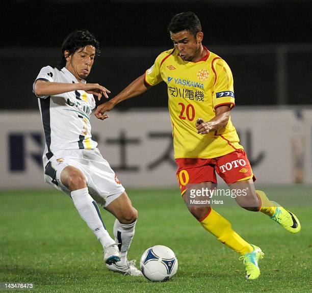 Takafumi Mikuriya of Thespa Kusatsu and Leonardo of Giravanz Kitakyushu compete during the JLeague Second Division match between Thespa Kusatsu and...