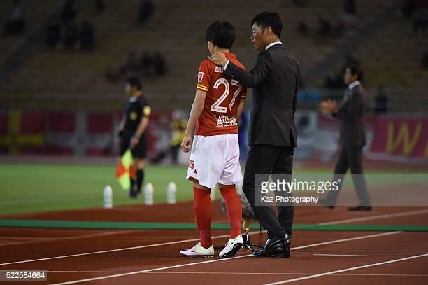 Takafumi Ogura, manager of Nagoya Grampus, instructs Koki Sugimori of Nagoya Grampus being substituted during the J.League Yamazaki Nabisco Cup match...
