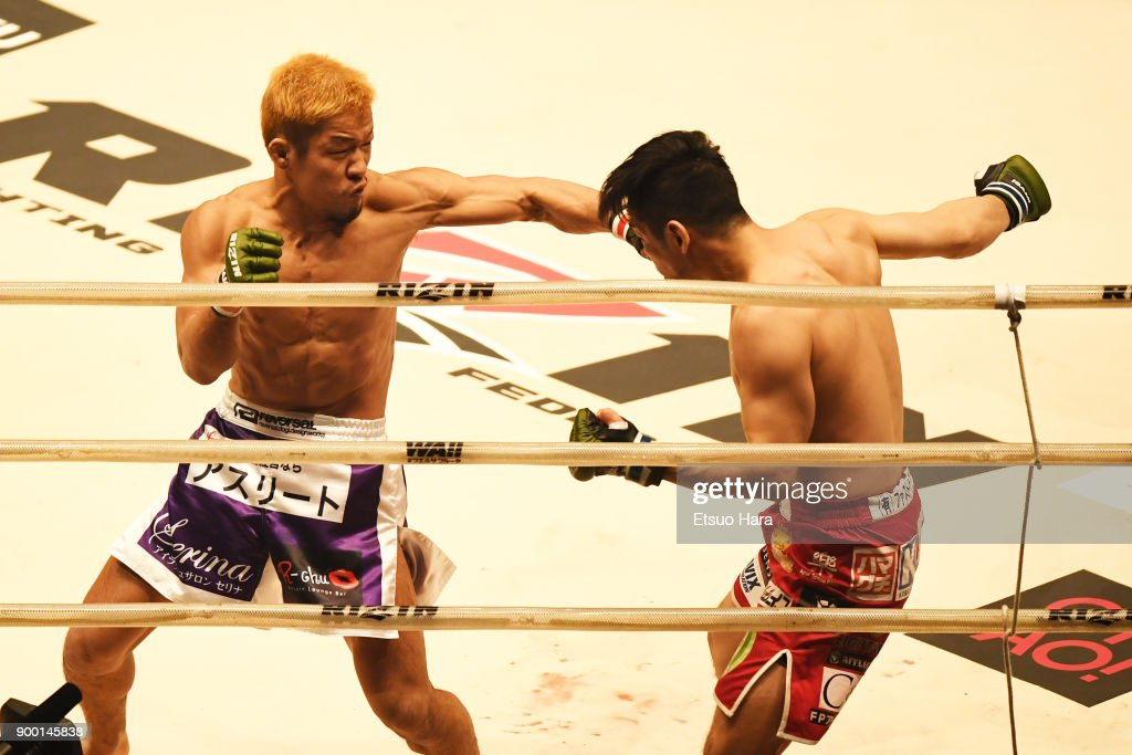 Takafumi Otsuka (L) of Japan punches Shintaro Ishiwatari of Japan in the bantam weight GP semi-final bout during the RIZIN Fighting World Grand-Prix 2017 final Round at Saitama Super Arena on December 31, 2017 in Saitama, Japan.