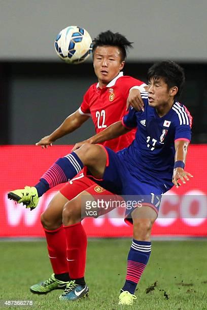Takagi Akito of Japan vies with Zhao Jianfei of China during a match between China and Japan of 2015 'Changan Ford Cup' CFA International Youth...