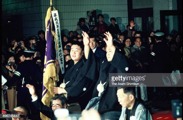 Takahanada celebrates winning the tournament with elder brother Wakahanada in the victory parade after day fifteen of the Grand Sumo New Year...