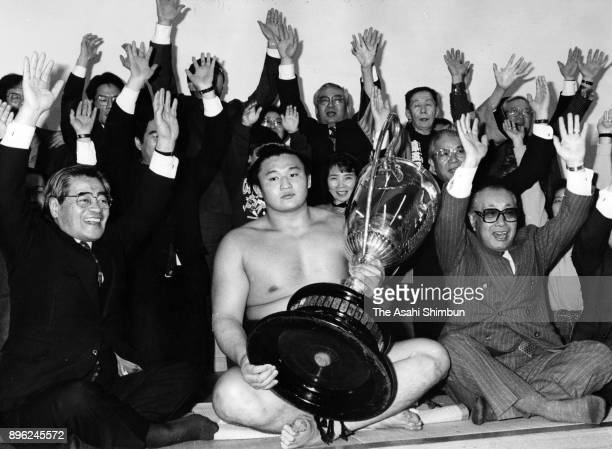 Takahanada celebrates with his supporters in the dressing room after winning the tournament during day fifteen of the Grand Sumo New Year Tournament...