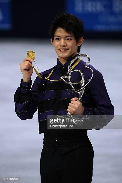 Takahiko Kozuka of Japan celebrates winning the Gold Medal in the Men's Program during the ISU GP Trophee Eric Bompard 2010 at the Palais omnisport...