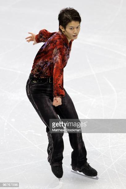 Takahiko Kozuka of Japan competes in the men's figure skating short program on day 5 of the Vancouver 2010 Winter Olympics at the Pacific Coliseum on...