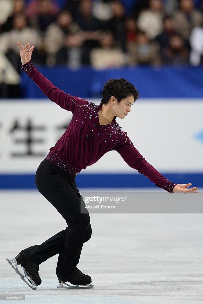 Takahiko Kozuka of Japan performs in the men's free skating during All Japan Figure Skating Championships at Saitama Super Arena on December 22, 2013 in Saitama, Japan.