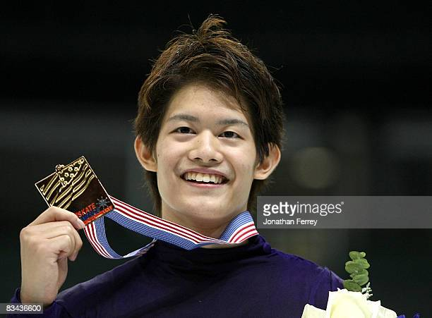 Takahiko Kozuka of Japan poses with his gold medal after winning the 2008 Skate America held at the Comcast Arena on October 25, 2008 in Everett,...