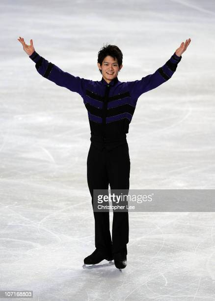 Takahiko Kozuka of Japan salutes the fans after he performs in the Mens Free Skating Program during the ISU GP Trophee Eric Bompard 2010 at the...