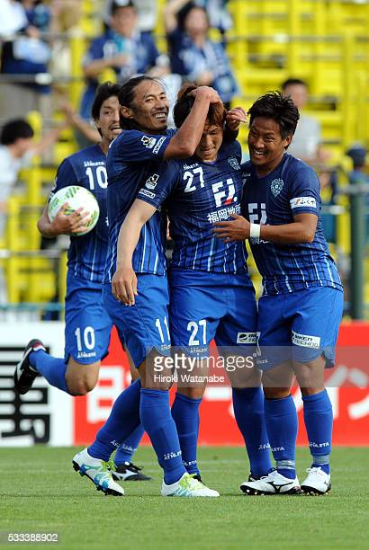 Takahiro Kunimoto of Avispa Fukuoka celebrates scoring his team's first goal with his team mates during the JLeague match between Kashiwa Reysol and...
