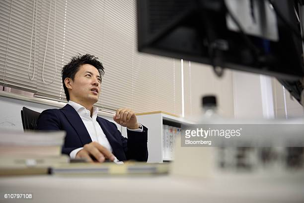 Takahiro Kusakari chief investment officer of Sawakami Asset Management Inc sits in front of a computer at the company's office in Tokyo Japan on...