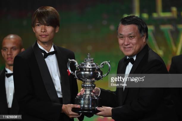 Takahiro Ohgihara receives the trophy from JFA President Kozo Tashima during the JLeague Awards on December 08 2019 in Tokyo Japan