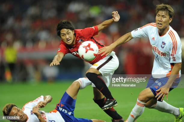 Takahiro Sekine of Urawa Red Diamonds in action during the JLeague J1 match between Urawa Red Diamonds and Albirex Niigata at Saitama Stadium on July...