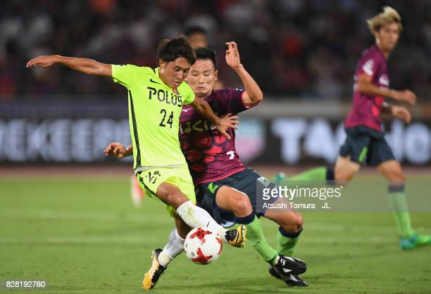 Takahiro Sekine of Urawa Red Diamonds is tackled by Toshio Shimakawa of Ventforet Kofu during the JLeague J1 match between Ventforet Kofu and Urawa...