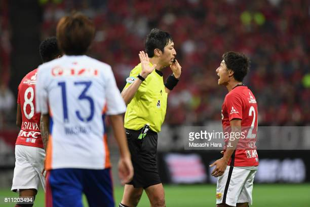 Takahiro Sekine of Urawa Red Diamonds protests against referee Tomohiro Inoue during the JLeague J1 match between Urawa Red Diamonds and Albirex...